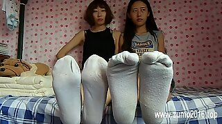 2 japanese women under sneakers