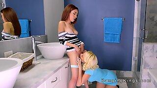 Blonde Milf licks teen in bathroom